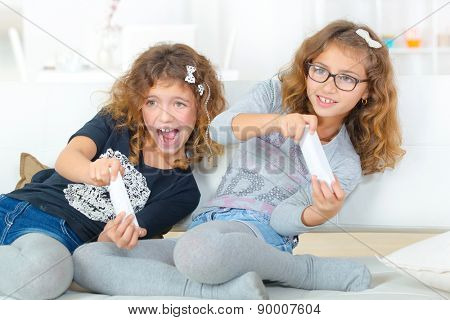 Sisters playing on a games console