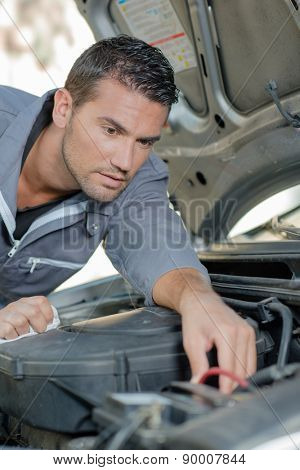 mechanic working in engine bay