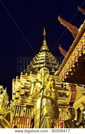 Golden Pagoda And Buddhist Statue