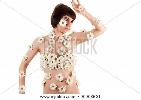 woman in inflorescences of chrysanthemums on the body