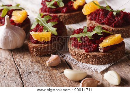 Sandwich With Beets, Oranges And Rucola Close-up. Horizontal