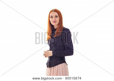 Elegant redhead woman smiling at the camera in studio