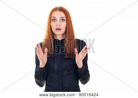 Portrait of a beautiful redhead woman unpleasantly surprised