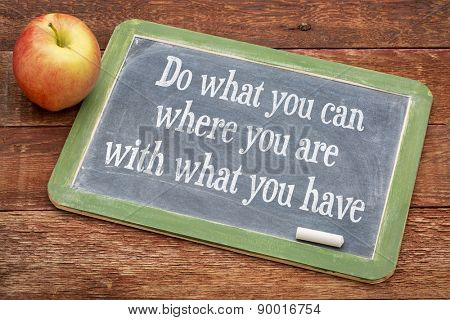 Do what you can, where you are, with what you have  - motivational words on a slate blackboard against red barn wood