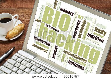 biohacking -  managing one's own biology using a combination of medical, nutritional and electronic techniques - word cloud on a digtal tablet