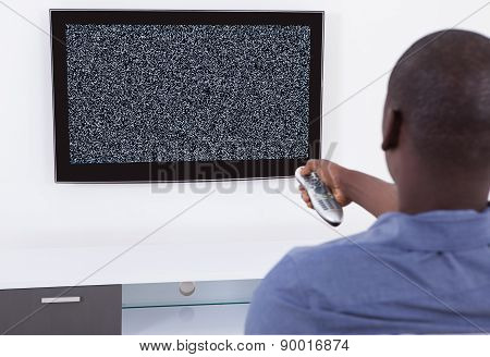 Man With Remote Watching Television