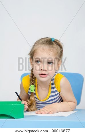 The Girl Drawing With Pencils At The Table Looked Left