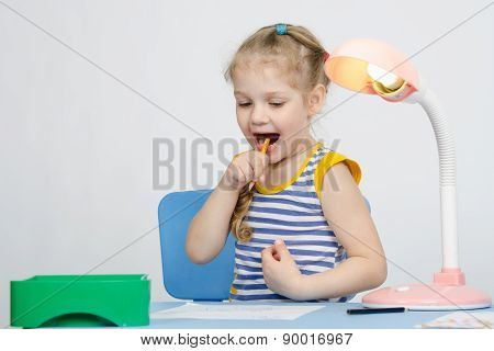 Happy Little Girl Drawing A Pencil Stuck In Her Mouth