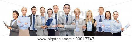 business, people, corporate, teamwork and office concept - group of happy businesspeople