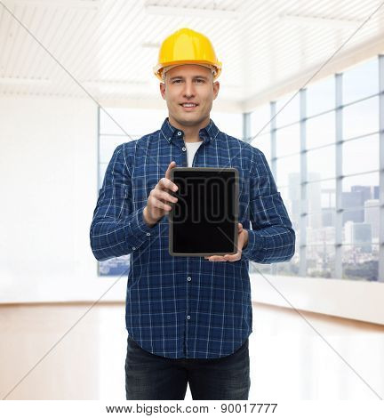 repair, construction, building, people and maintenance concept - smiling male builder or manual worker in helmet showing tablet pc computer blank screen over empty flat background