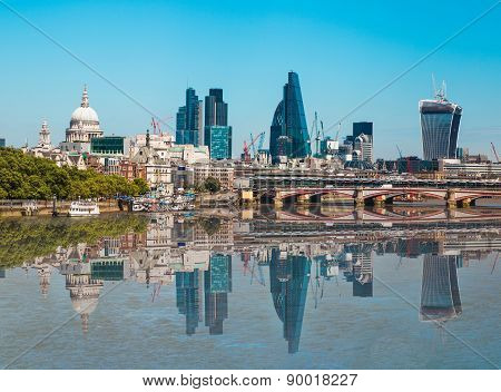 LONDON, UK - 22 JULY, 2014: City of London view from the London bridge. St. Paul cathedral, Lloyds b