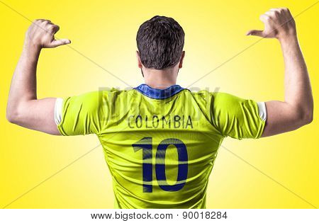 Colombian soccer player on yellow background