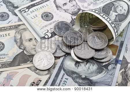 US  Dollar Banknotes And Coins.