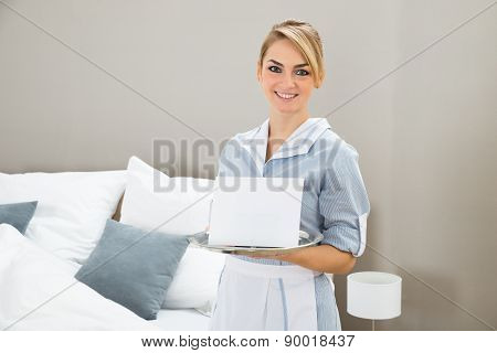 Woman Holding Tray With Placard