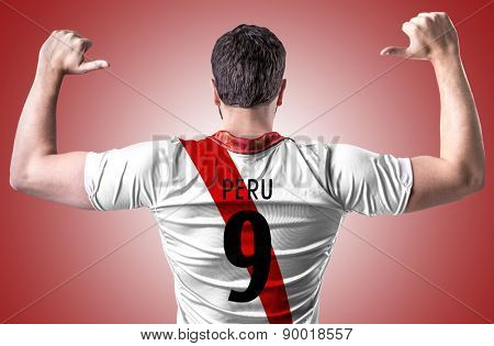 Peruvian soccer player on red background