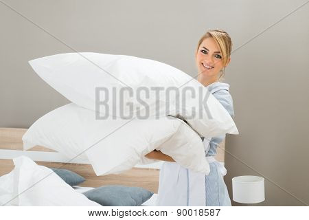Housekeeping Worker With Pillows