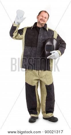 Welder with mask in hands.