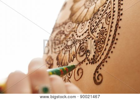 Art of mehndi. Complex pattern on body, close-up