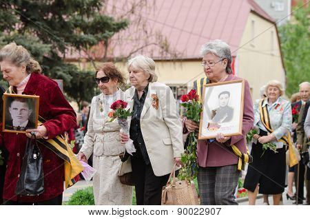 Older Women Veterans Coming The Monument To Lay Flowers