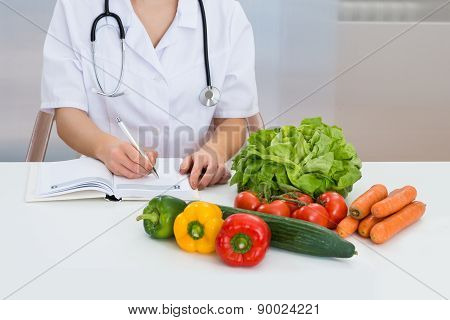 Female Dietician Writing Diet Plan