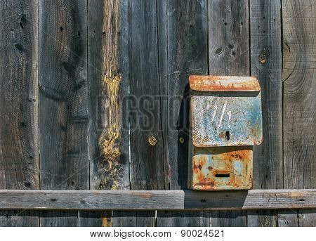 Old Mailbox On Fence