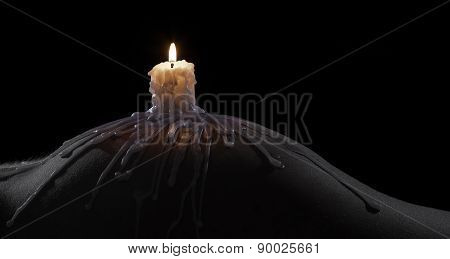 Body Scape Of A Well-shaped Woman With Burning Candle And Wax On Her Bum