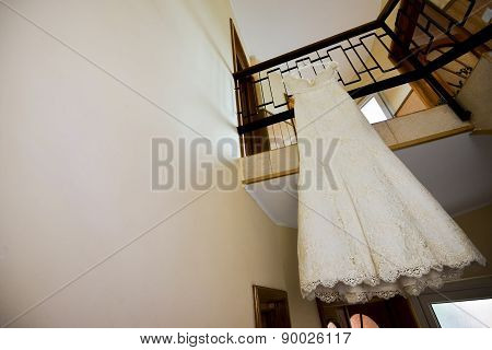 Wedding Dress Hanging From The Railing