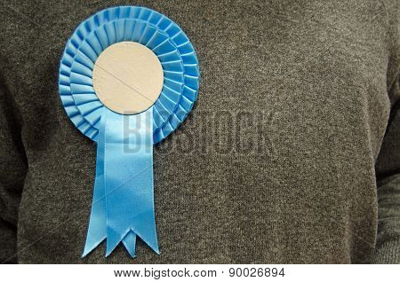 Blue Rosette on Conservative Party Supporter