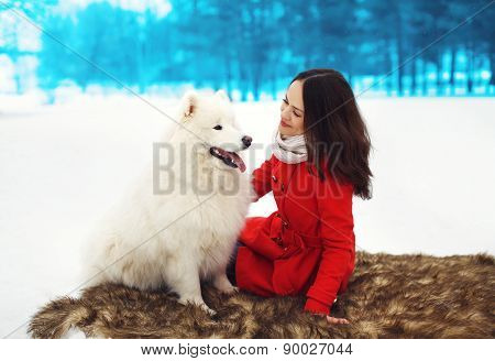 Happy Woman Owner Having Fun With White Samoyed Dog Outdoors In Winter Day