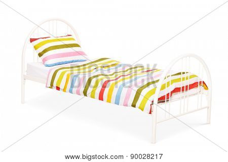 Studio shot of a white bed with a blanket and a pillow on it isolated on white background