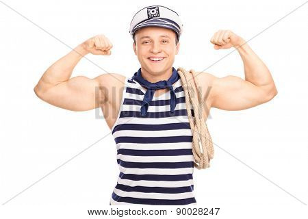 Strong sailor with a rope around his shoulder showing his biceps isolated on white background