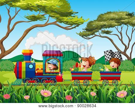 Children riding on train in the forest