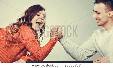 Arm Wrestling Challenge Between Young Couple
