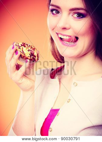 Woman Holds Cake In Hand Licking Lips
