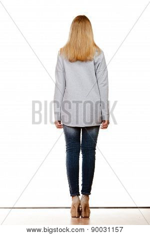 Woman In Denim Pants Gray Blouse Back View