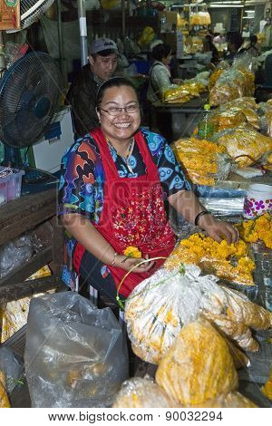 Women Are Selling Fresh Flowers At The Morning Market