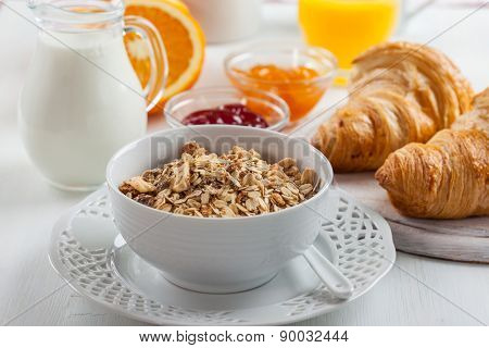 Breakfast with cereal, milk, orange juice