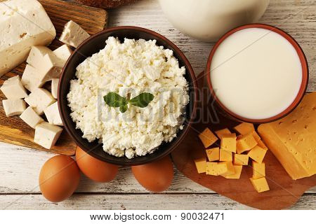 Tasty dairy products on wooden table close up