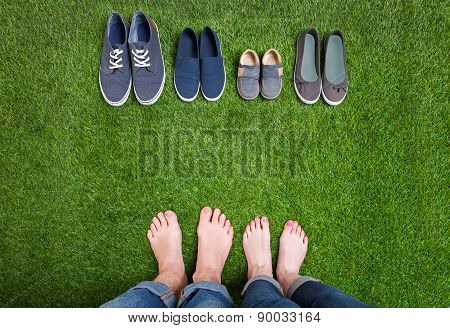 Men and woman legs with shoes standing  on grass
