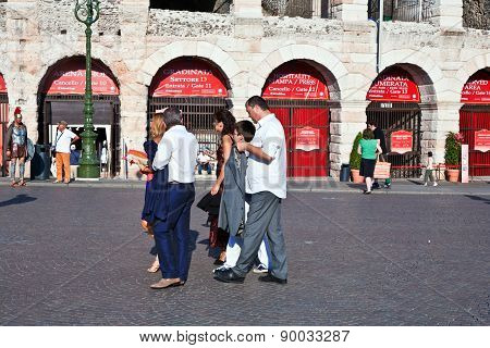 Visitors, Spectators Are Waiting Outside The Arena Di Verona For Entrance In The Opera Late Afternoo