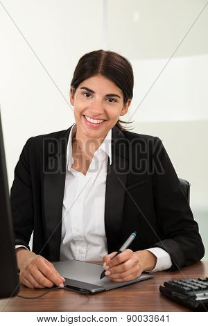 Female Designer Using Graphic Tablet