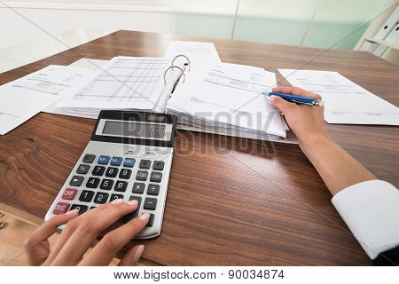 Businessperson Hands Calculating Bill