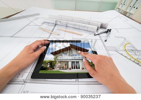 Businessperson With Digital Tablet And Blueprint