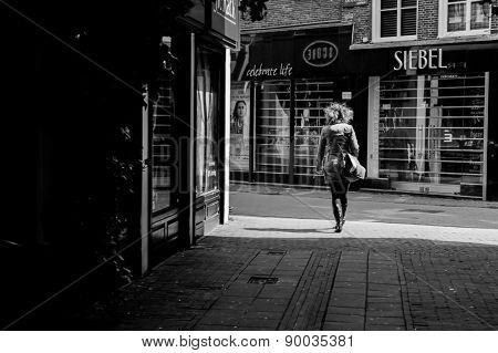 AMSTERDAM, NETHERLANDS - 18 MAY: Woman on streets on 18 May 2009 in Amsterdam, Netherlands. Amsterdam is the capital and most populous city of the Netherlands.