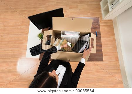 Businesswoman Packing Personal Belonging In Box