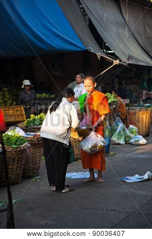 People Donate Food To The Monk