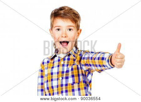 Portrait of a cheerful 7 year old boy showing thumb. Copy space. Isolated over white.
