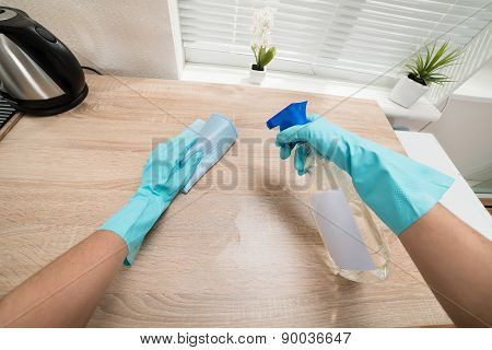 Person Hands Cleaning Kitchen Worktop
