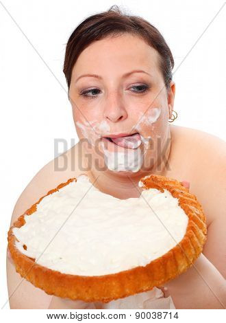 Overweight woman eating sweet cake with whipped cream.