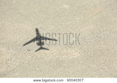 Model of plane over asphalt background